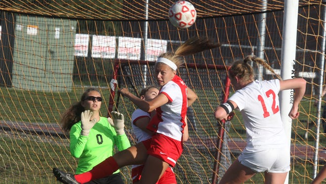 Somers' Hannon Eberts, (12), heads the ball towards North Rockland goalie Nicole Solicito during their game at Somers Sept. 23, 2015. Somers won 5-2 in overtime.