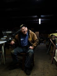 Maynard Hansen, 80, poses for a portrait in his tractor