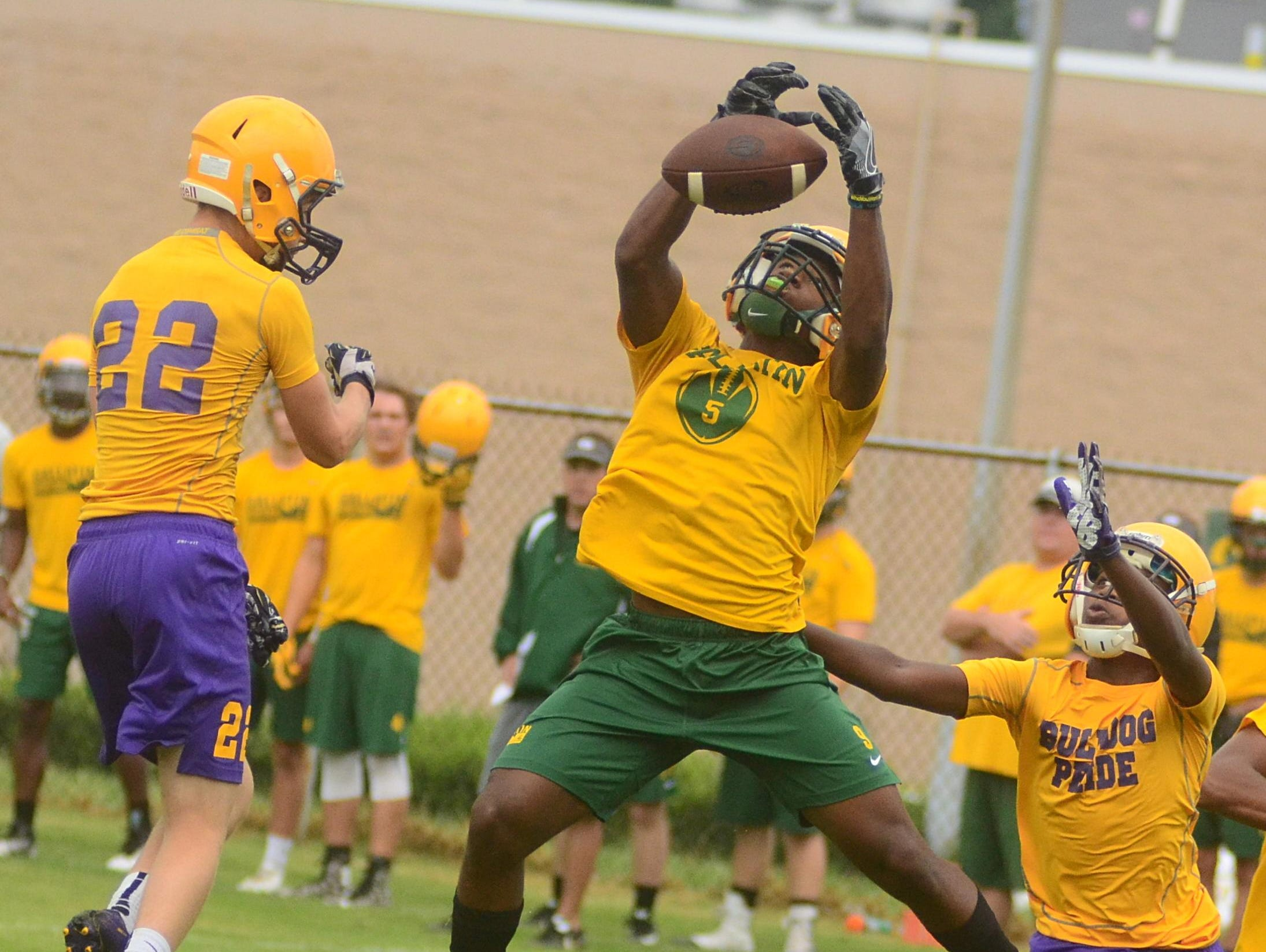 Gallatin High senior wide recevier Dezmond Chambers leaps to make a catch against Smyrna during 7-on-7 action.