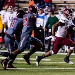 New Mexico State running back Larry Rose III (3) carries against Louisiana-Lafayette during an NCAA college football game in Lafayette Saturday.