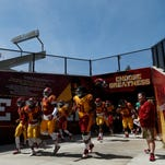 ISU players enter Jack Trice Stadium for their annual spring game on Saturday, April 16, 2016 in Ames.