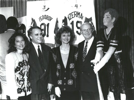 Former Detroit Red Wings executive vice president Jim Lites, second from left, is pictured in this 1992 photo, from left, with Denise Ilitch, Melissa Franco and Tony Franco.