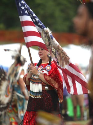 Grand entry of dancers competing at the Bear Mountain Pow Wow at Anthony Wayne Recreation Area in Harriman State Park Aug 2, 2014. The event was put on by the Redhawk Native American Arts Council.