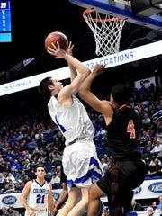 "CJ Fredrick drives the lane and drops in two pints for Covington Catholic in their win over Fern Creek, at the KHSAA Basktball Tournament ""Elite Eight"", Lexington, KY, March 16, 2018."