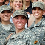 In this 2015 photo, Army 1st Lt. Shaye Haver, center, and Capt. Kristen Griest, right, pose for photos with other female West Point alumni after an Army Ranger school graduation ceremony at Fort Benning, Ga. Haver and Griest became the first female graduates of the Army's rigorous Ranger School. The decision by the Pentagon to allow women to serve in all combat jobs has put new focus on an often-forgotten U.S. institution: the Selective Service. While America has not had a military draft since 1973, all men must register with the Selective Service within 30 days of turning 18. U.S. leaders repeatedly insist that the all-volunteer force is working and the nation is not returning to the draft. But there are increasing rumblings about whether women should now be required to register if they can indeed serve in all areas of the military.