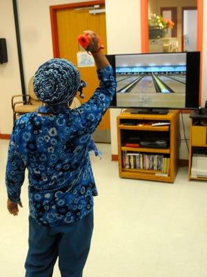 Jeanette Finney throws the ball in a game of Wii Bowling at the CHEER Activity Center in Georgetown Wednesday, April 6.