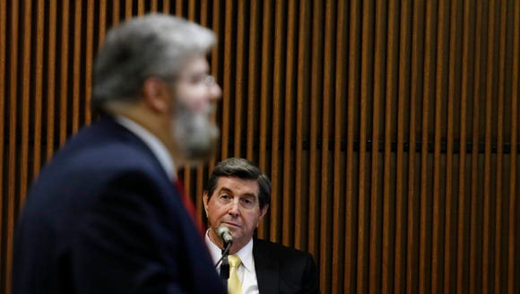 Former Alabama Gov. Bob Riley listens asprosecutor