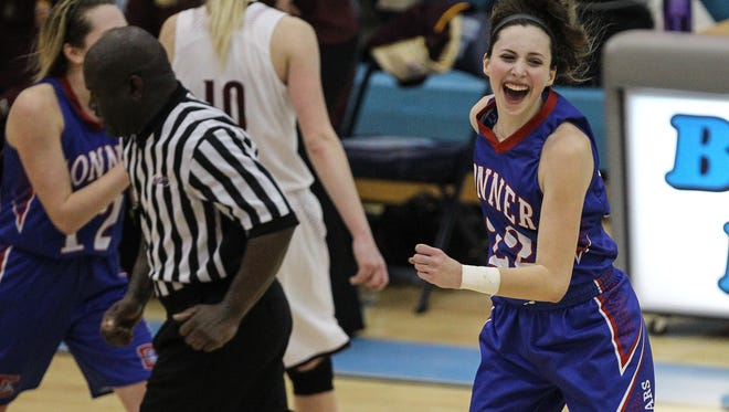 Maddie Burcham celebrates Conner's 61-57 win over Cooper in their 33rd District final.