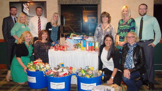Members of the Young Professionals of Fond du Lac (YPF) organized a food drive helping to stock the shelves at the Fondy Food Pantry. Over six donation bins were filled at the YPF Casino Night Fundraiser held at South Hills Golf & Country Club on Sept. 19. From front left: YPF members Theresa Menting, Katie Leist, Nora Hernández and Fondy Food Pantry board of directors president Sarah Zimmerman. Standing from left: YPF members Nick Nell, Amy Jessen, Bill Baus, Jenny Knuth, Christina Plummer,  Jill Faber and Joe Truesdale.