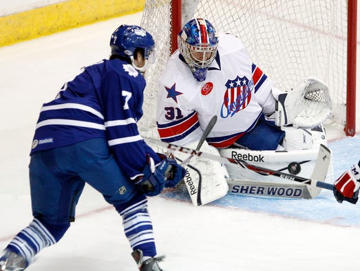 Rochester goaltender Nathan Lieuwen, right, makes a save on Toronto's Wade MacLeod during AHL action between the Toronto Marlies and the Rochester Americans at the Blue Cross Arena in Rochester on Friday, Oct. 18, 2013. The Amerks won 4-1.
