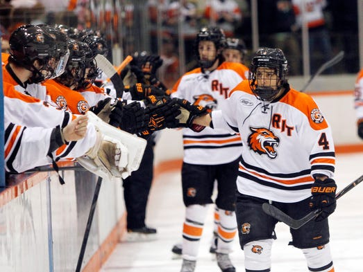 RIT's Mike Colavecchia, right, high fives the bench during a 6-0 win over Army.