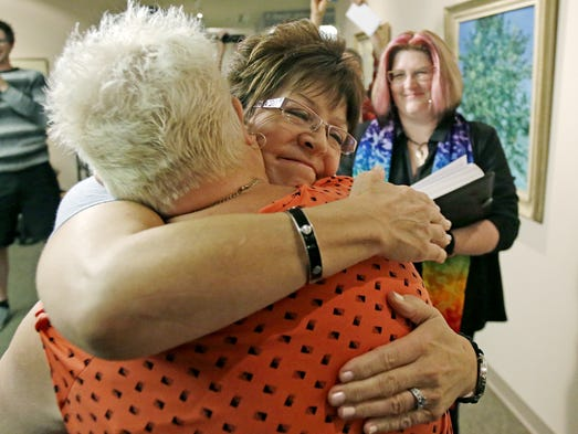 Sherri Ault, right, and Leslie McWilliams hug after getting married at the Salt Lake County clerk's office in Salt Lake City.