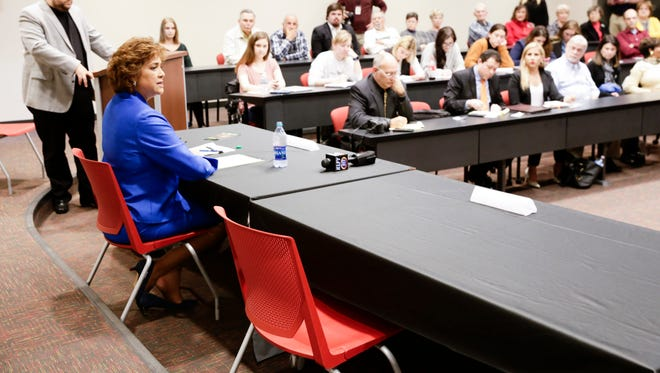 Susan Theall addresses the room as the only candidate for the 3rd Circuit Court of Appeal to appear at a scheduled debate at UL Lafayette Tuesday, March 14, 2017. Vanessa Anseman was absent because she is appealing a court decision ruling her ineligable to run.