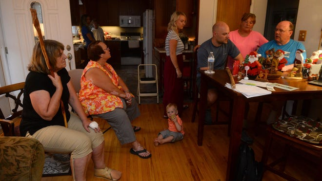Richard Robinson's family gathered Thursday to remember his life.