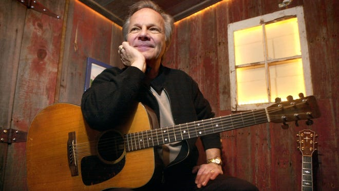 Bobby Vee poses with a guitar in April 2004 at Rockhouse Productions in St. Joseph.
