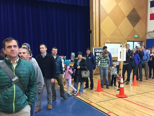 A line of voters extends outside from Edmunds MIddle