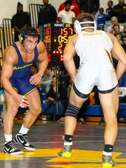 U-M's Alec Pantaleo (left), a Canton grad, fell to ASU's Josh Shields, 4-3, in the final 20 seconds at 157 pounds.