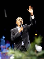 U.S. Sen. Barack Obama waves to his supporters as he