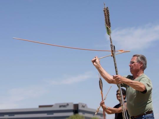 Bob Sizemore throws an atlatl dart with an atlatl. Archeologists have found mammoth kill sites near Sierra Vista containing atlatl dart points.  where Pat Shannahan/The Arizona Republic