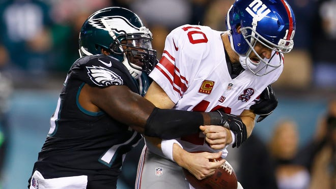 Eagles defensive end Vinny Curry sacks Giants quarterback Eli Manning during the first half Sunday night.