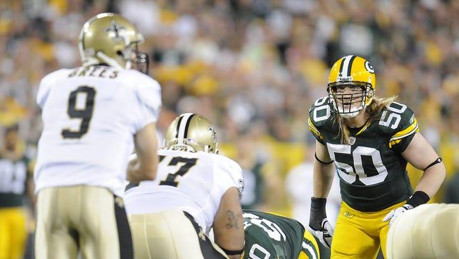 Green Bay Packers linebacker A.J. Hawk (50)stares down New Orleans Saints quarterback Drew Brees (9) during the 2011 season opener at Lambeau Field.