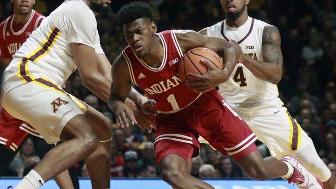 Minnesota's Jordan Murphy (3) and Jamir Harris (4) cover Indiana's Aljami Durham (1) during the first half of an NCAA college basketball game Saturday, Jan. 6, 2018, in Minneapolis. (David Joles/Star Tribune via AP)
