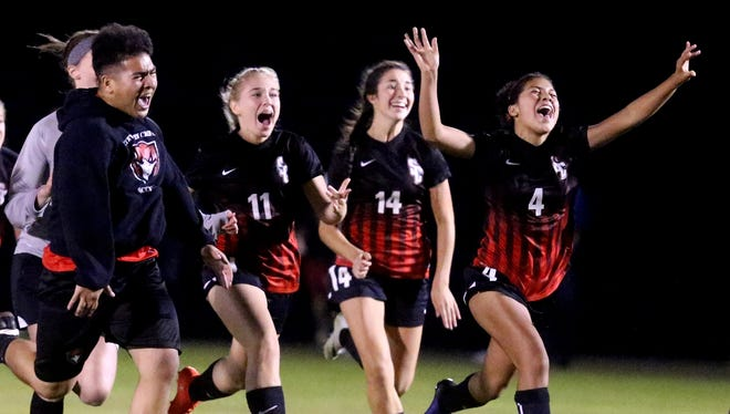 Stewarts Creek players and manager rush the field after beating Oakland in the 7-AAA semifinals last season. The Lady Red Hawks return several starters.