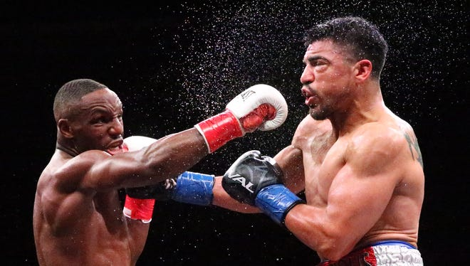 Devon Alexander, left, lands a hard punch to the face of Victor Ortiz Saturday in the Don Haskins Center. Officials ruled the hard fought bout a draw.
