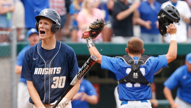 Carson Barrett of Central Catholic reacts after striking out on a called third strike for the final out in the bottom of the seventh inning against Boone Grove in the baseball semistate Saturday, June 9, 2018, in Plymouth. CC fell to Boone Grove 1-0.
