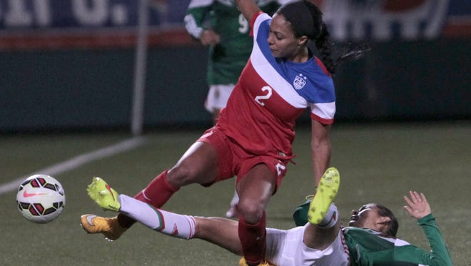 USA's Sydney Leroux is taken down by Mexico's Paulina Solis during their game Sept. 18, 2014 at Sahlen's Stadium in Rochester.