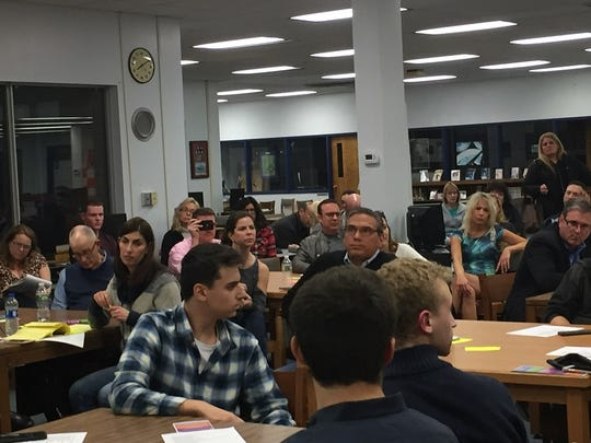 Superintendent Joseph Meloche takes questions Monday night from an often-unhappy audience in Cherry Hill.