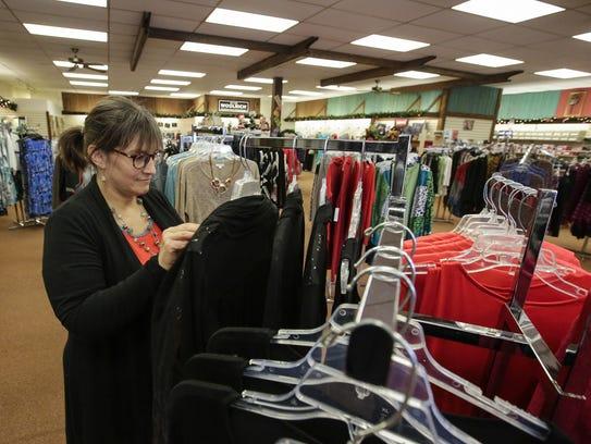 Angie Bonk, Schroeder's ladies buyer, arranges a rack