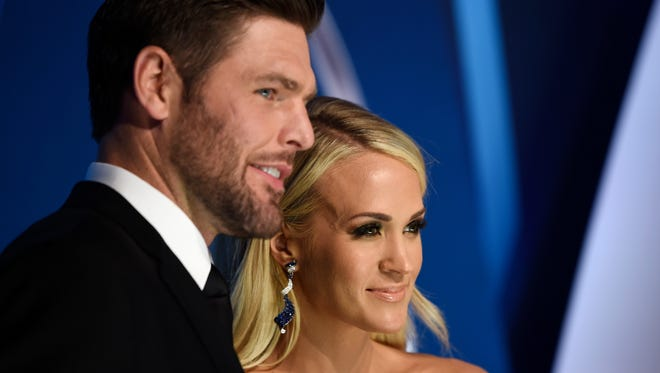 Carrie Underwood and husband Mike Fisher on the red carpet at Music City Center before the start of the 51st annual CMA Awards Wednesday, Nov. 8, 2017 in Nashville, Tenn.