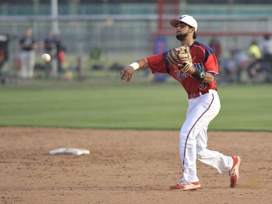 Tulare Western's Blaze Hickey throws against Mission Oak on Thursday in an East Yosemite League game at Tulare Western.