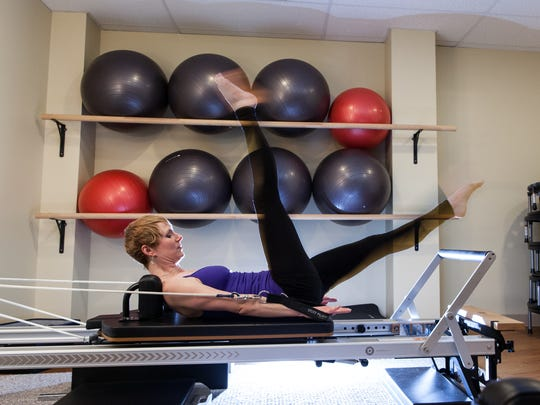 Janczak in her Core Rhythm Pilates Studio. She credits Pilates with helping her recover from an injury she sustained as a dancer.