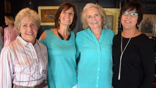 Women's Refuge board members Langie Mannion, Lanie Bishop, Donna Lee Robart, and Pat Marine