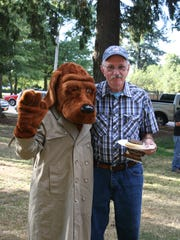 McGruff makes the rounds on National Night Out; rubs elbows with Stayton Mayor Hank Porter.