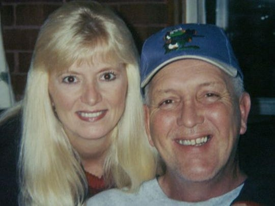This is a copy of a family photograph of Lawrenceburg police Detective Sgt. Thomas Cochran, right, and his wife Jo'Nee.(Photo: