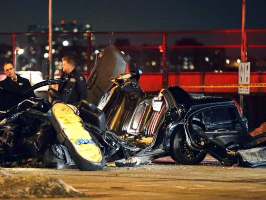 Officials survey the scene of an accident following