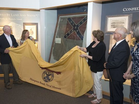 A flag from the Confederate ship CSS Hampton is unveiled
