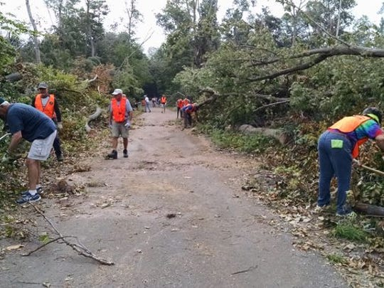 Friends of Sleeping Bear Dunes Trail crew clean up after a severe storm ripped through the area.