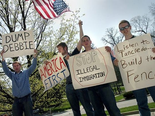 Craig Burgers, from left, Will Burgers Joseph Ryzyi and Kyle Bristow of Young Americans for Freedom protest outside the Student Union in 2006 on the MSU Campus.
