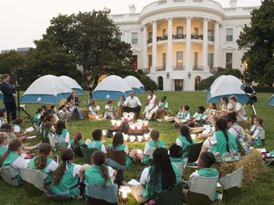 Girl Scouts, some shown here in June meeting at the White House, have been pushing for their founder to be on the $10 bill.