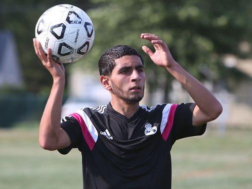 Port Chester's Steven Hernandez moves the ball during soccer practice at Port Chester High School Aug. 18, 2015.