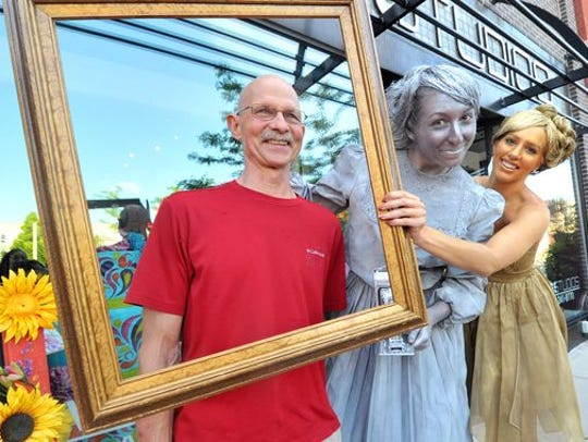Lee Koch, left, poses for a photo with Emily Voss and