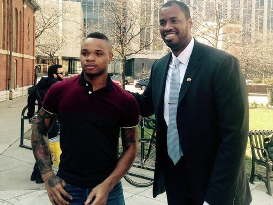 Derrick Gordon with NBA pioneer Jason Collins.