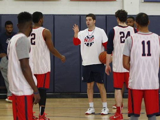 Jim Engles (center) coaches NJIT during a 2015 practice.