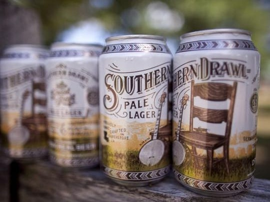 A can of Great Raft's Southern Drawl is a hop-forward lager with complex, citrusy aromas derived from German hops and wheat phenols.