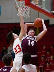 Brownwood's Zach Strong (14) battles with Sweetwater's Logan Wedin for a rebound during SHS' 41-35 win over Brownwood on Fri., Jan., 26, 2018.