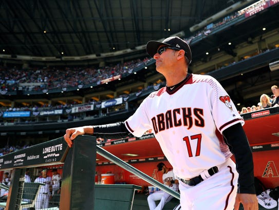 Diamondbacks manager Torey Lovullo stands in the dugout
